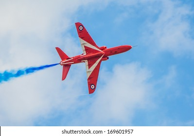 CLEETHORPES, ENGLAND - JULY 28, 2013: Royal Air Force aerobatic display team The Red Arrows fly past Cleethropes sea front