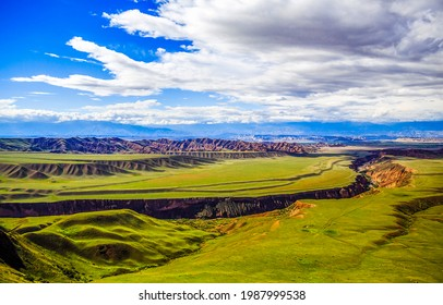 A cleft in a mountain valley. Mountain valley landscape. Green valley in mountains - Shutterstock ID 1987999538