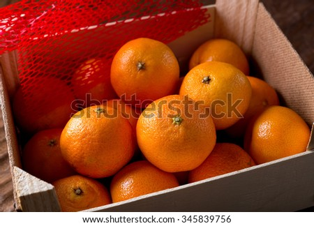 Clementine oranges in packing crate.