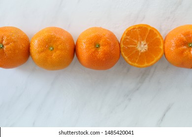 Clementines frame white marble copy space.