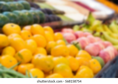 Clementines on sale, blurred background.