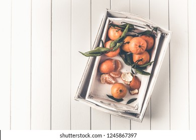 Clementines tangerines in a white tray