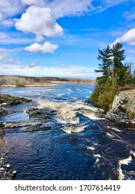 Clementson, Minnesota. Rapid River. Spring river rushing through the channel. White water.