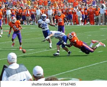 CLEMSON, SC - SEPT. 11:Presbyterian's quarterback fumbles the ball on September 11, 2010 in Clemson, South Carolina.  Clemson defeated Presbyterian 58-21.