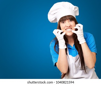 Clench Of Woman Cook On Blue Background