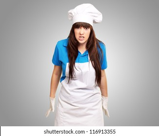 Clench Of Woman Cook On Gray Background