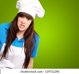 Clench Of Woman Cook On Green Background