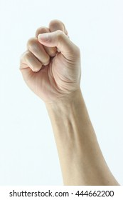 clenched fist hand closeup white background conceptual studio