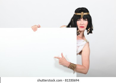 Cleopatra pointing at sign