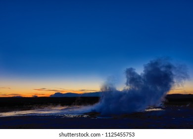 Clepsydra geyser in Yellowstone National Park in Wyoming erupts almost continuously and is beautiful at sunset.  It is located in the Lower geyser basin.