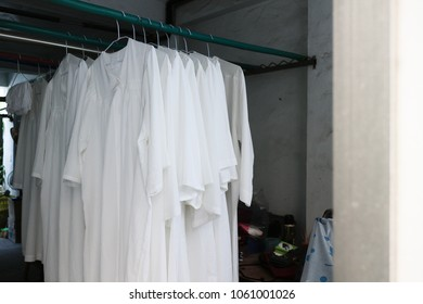 Clergy's white clothes. Dry on clothes hangers. The priests and priests wore in the church.Medium shot.