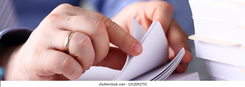 Clerk arm bend over pages in pile of documents closeup. Open catalogue correspondence order organization heap archive job sorting records concept