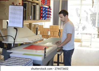 Clerk checking the print result.