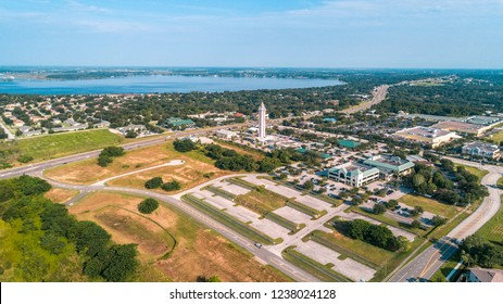 Clermont, FL / Lake County - August 27th 2018: A serene day in the peaceful city of Clermont. A birds eye view of the historic Citrus Tower with Lake Minneola of the Chain of Lakes in the background.
