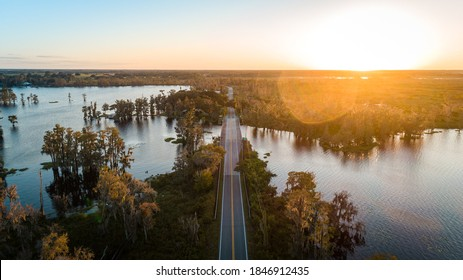 """Clermont, FL / USA - 11/3/2020: Beautiful sunset over the 561 bridge near Lake Minnehaha and Lake Palatlakaha on the Clermont Chain of Lakes."""
