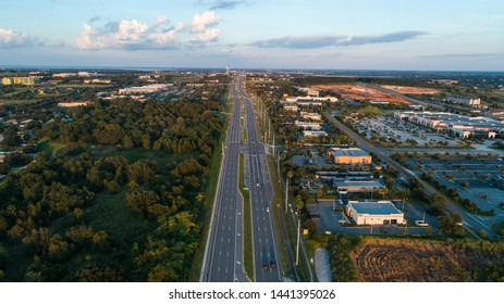 """""""Clermont, FL / USA - 1/20/2019: Golden hour over the Highway 50 in Clermont, FL."""""""