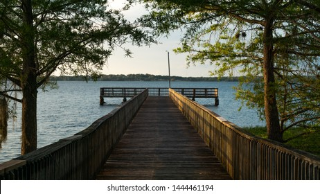 """""""Clermont, FL / USA - 1-20-2019: The public dock at downtown Clermont."""""""