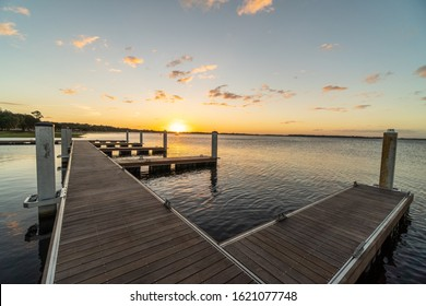 """Clermont, FL / USA - 1-9-2020: Standing on the docks of the city of Clermont's newly completed boat ramp during sunset."""