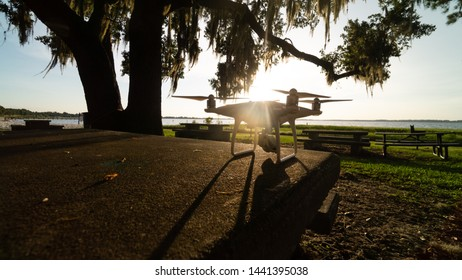 """""""Clermont, FL / USA - 7-1-2019: Drone at sunset at waterfront park in Clermont, FL."""""""