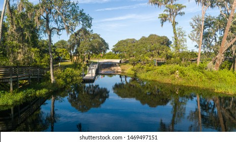 """""""Clermont, FL / USA - 7-23-2019: Drone photo over the water at Palatlakaha river park & boat ramp."""""""