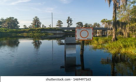"""""""Clermont, FL / USA - 7-23-2019: Drone photo over the water at the 561 bridge at the intersection of Lake Minnehaha and Lake Palatlakaha."""""""