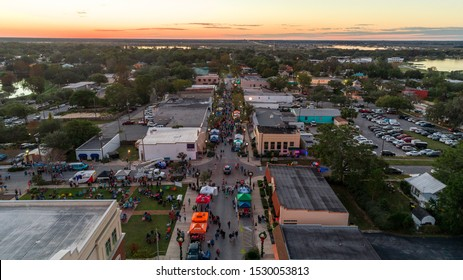 """Clermont, FL / USA - 9/03/2018: Aerial View of First Friday in Downtown Clermont."""