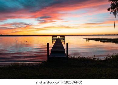 """Clermont, FL / USA - 9-30-2020: Beautiful twilight shot of a dock on Lake Minnehaha."""