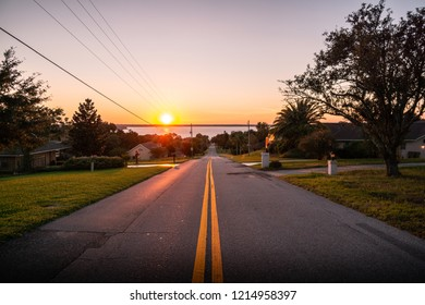 Clermont, FL /USA - October 13th 2018:  A surreal sunset on Anderson Hill Road radiates its last rays of sunlight over Lake Minnehaha in Clermont, FL.