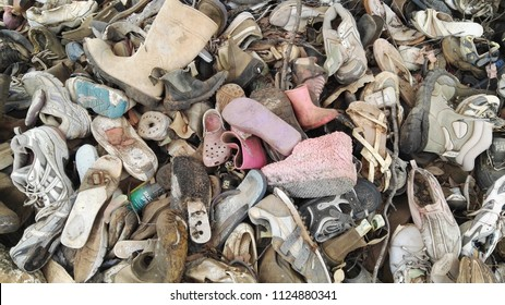 Clermont, Queensland, Australia, July 1st 2018, Group of old discarded shoes