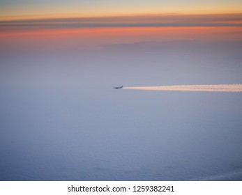 CLERMONT-FARRAND, FRANCE - DECEMBER 15, 2018: Airbus A380 aircraft operated by Emirates caught flying above the clouds over France on December 15, 2018.
