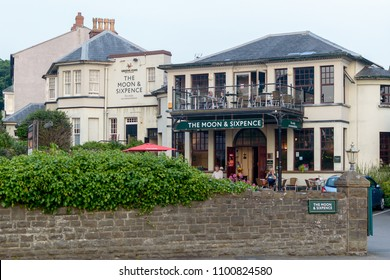 Clevedon, England - May 28, 2018: The Moon and Sixpence Pub along Clevedon Seafront, shallow depth of field horizontal photography