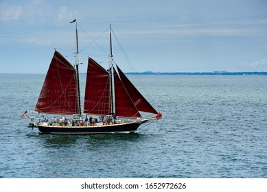 CLEVELAND, OH - JULY 11, 2019: The tall ship Inland Seas, sails on Lake Erie with the eastern shorline visible in the distance in the 2019 Tall Ships Festival.