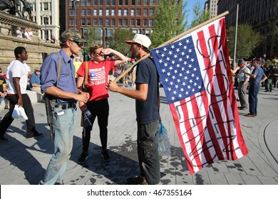 Cleveland, OH July 19, 2016: Republican National Convention - A Man with a rifle argues with a democratic support over their beliefs
