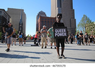 """Cleveland, OH July 19, 2016: Republican National Convention - A Gay rights activist holds a sign saying """"Queer Power"""" in protest of Donald Trump"""