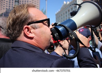 Cleveland, OH July 19, 2016: Republican National Convention - Conservative figure, Alex Jones, uses a megaphone to voice his opinion as he increases the level of tension between protesters