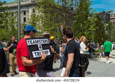 CLEVELAND, OH - JULY 20, 2016: A Trump supporter holds a sign among the crowds of people on Public Square during the Republican National Convention