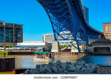 CLEVELAND, OH - MAY 25, 2018: The  Water Taxi ferries visitors across the Cuyahoga River without charge, enabling visits to venues on both banks. The taxi crosses under the Main Avenue highway bridge.
