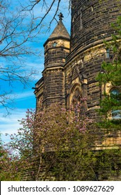 CLEVELAND, OH - MAY 5, 2018: Closeup of the Garfield Memorial in Cleveland's Lakeview Cemetery with flowering redbud tree. The memorial was built in 1890 to honor President James A. Garfield.