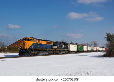 CLEVELAND, OH - November 15: Norfolk Southern locomotive 1071 in the Jersey Central Lines Heritage paint scheme makes an infrequent trip through Cleveland, Ohio on a snowy November 15th, 2014