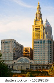 CLEVELAND, OH - OCTOBER 4, 2019: The Tower City Center, a downtown shopping and meeting venue since the 1990s, faces the riverfront with Terminal Tower rising behind it in golden sunlight.
