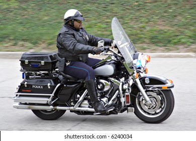 A Cleveland Ohio motorcycle police officer in action.