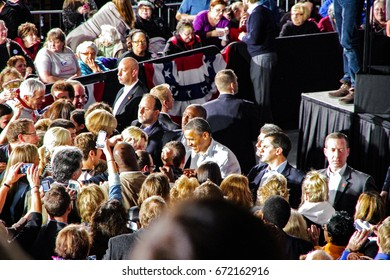 CLEVELAND, OHIO - November 3, 2012: President Obama shaking hands with his supporter in a re-election campaign rally in Cleveland, OH. Editorial Use Only.