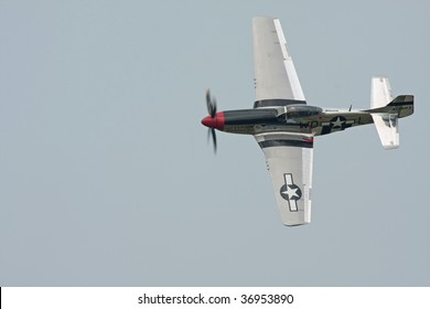 CLEVELAND, OHIO - SEPT. 6: a P-51 Mustang fighter aircraft flies at the Cleveland National Airshow on Sept. 6, 2009 in Cleveland, Ohio.