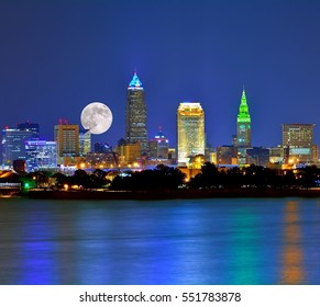 Cleveland Ohio skyline and Lake Erie at night.