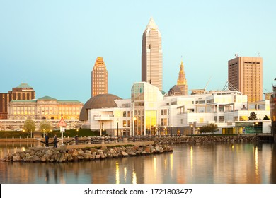 Cleveland, Ohio, United States - Great Lakes Science Center building and skyline of downtown at sunset.