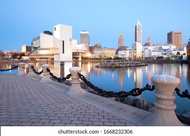 Cleveland, Ohio, United States - The modern building of the Rock and Roll Hall of Fame Museum. and downtown skyline.