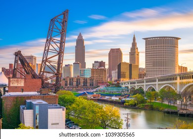 Cleveland, Ohio, USA city skyline over the Cuyahoga River.