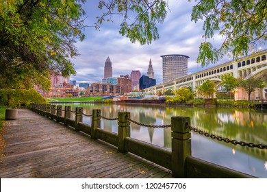 Cleveland, Ohio, USA downtown skyline on the Cuyahoga River at dusk.