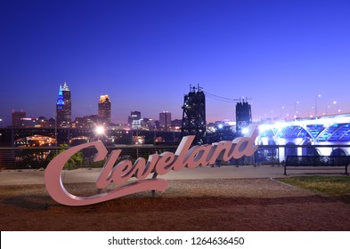 CLEVELAND, OHIO, USA - JULY 12, 2018: Night view of Cleveland script sign and city skyline from Tremont, Ohio just before break of dawn. July 12, 2018