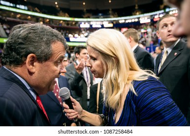 Cleveland Ohio, USA, July 18,  2016 New Jersey Governor Chris Christy sitting with the New Jersey state delegation to the Republican National Convention is interviewed by WABC radio host Rita Cosby